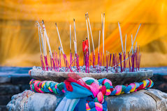 Joss stick and candle in joss stick pot Royalty Free Stock Photography