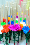 Joss stick decorate with paper flower. Craft stock image