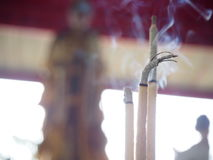 Joss stick. And incense burner in pot Stock Photo