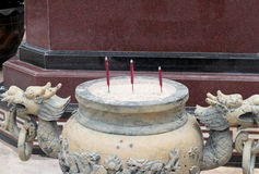 Joss stick pot with dragon sculpture in the temple Stock Images