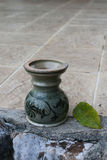 Joss stick pot. The green joss stick pot put on the floor.It is painting by patterns of folk art Stock Images