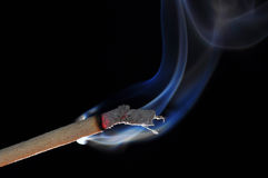 Joss stick with smoke. Close up joss stick with smoke in black backgound Royalty Free Stock Images