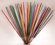 Group of colorful incense sticks on clay support Stock Photography