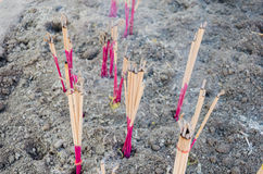 Joss sticks in an ashes Stock Photos