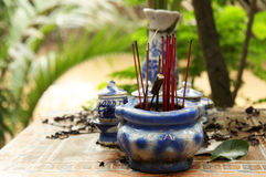 Joss Sticks. Buddhist altar with joss sticks in a tropical village Stock Photography