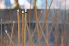 Joss sticks burning in big joss stick pot Royalty Free Stock Image
