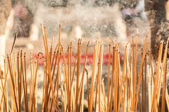 Joss sticks burning at a vintage Buddhist temple courtyard as offering during Chinese New Year in temple stock photo