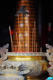 Joss Sticks and Incense Burning Pot Royalty Free Stock Images