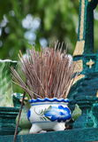 Joss sticks jar Royalty Free Stock Images