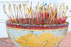 Joss-sticks on joss pot with yellow dragon Royalty Free Stock Photos