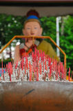 Joss Sticks and Religious Statues Royalty Free Stock Photos