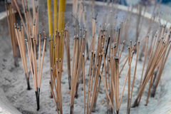 Joss Sticks Smolder on a Buddhist Altar in a temple Stock Images