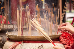 Joss sticks in to pot Royalty Free Stock Photo