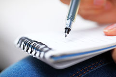 Jot down information on notpad. Jot down information on notepad close up Royalty Free Stock Image