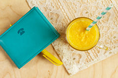 Jotter with pencil and fresh orange juice. Royalty Free Stock Photos