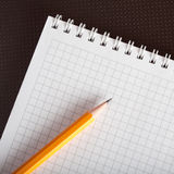 A jotter and a pencil Stock Photo