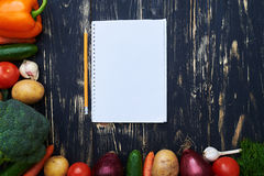 Jotter with a pencil surrounded with a collection of homegrown v Stock Image