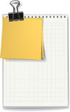 The jotter and stickers fastened by a binder clip Royalty Free Stock Photos