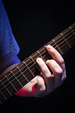Jouant Barre Chords On Guitar Close  Image stock