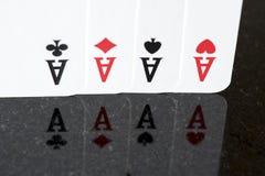 Jouant la carte, quatre qu'une sorte aces Image libre de droits
