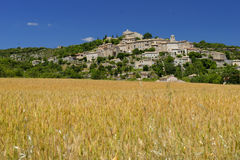 Joucas in Provence. Scenic view of Joucas commune on a hillside with a field in the foreground, Provence, France Stock Photos