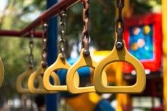 Joue divers dans le terrain de jeu pour l'enfant Photographie stock