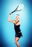 Jouer au tennis Images libres de droits
