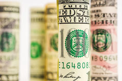 Jouer avec le centre du billet de banque américain du dollar roule Photos libres de droits