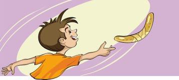 Jouer avec un boomerang Image libre de droits