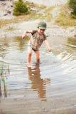 Jouer dans l'étang Photographie stock