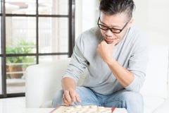 Jouer des échecs de la Chine Image libre de droits