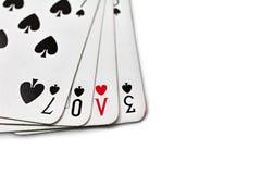 Jouer des cartes avec amour écrit Photo libre de droits