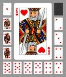 Jouer des cartes de costume et de dos de coeurs sur le fond vert Images libres de droits