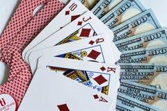 Jouer des cartes et des dollars images libres de droits
