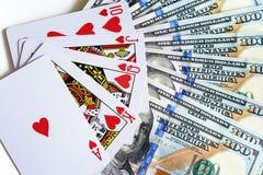 Jouer des cartes et des dollars photographie stock libre de droits