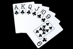 Jouer des cartes sur un fond noir, le concept de grand et la victoire photo libre de droits