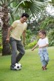 Jouer le football Photographie stock libre de droits