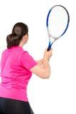 Jouer le tennis, le dos du ` s de femmes, et la raquette dans le cadre Image libre de droits