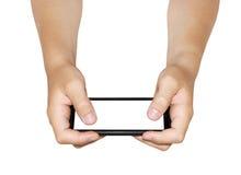 Jouer sur le smartphone Photo libre de droits