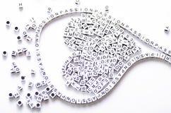 Jouet d'alphabet avec une passion de mot dans elle Image libre de droits
