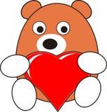 Jouet d'ours de chéri de dessin animé avec le coeur rouge Images stock