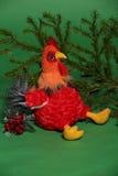 Jouet de coq avec la branche impeccable Photo stock