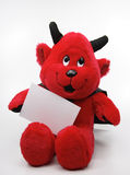 Jouet de diable avec une note blanc Image stock