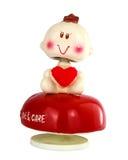 Jouet de poupée avec le coeur rouge Photos libres de droits