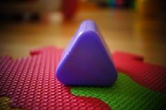 Jouet de triangle Images stock
