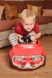 Jouet de véhicule de garçon Photos stock