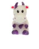 Jouet de vache à poupée sur le fond blanc Image stock