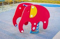 Jouet elefant au terrain de jeu Photographie stock