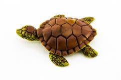 Jouet en caoutchouc de tortue d'isolement sur le fond blanc Photos libres de droits