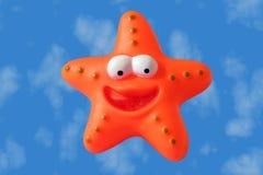 Jouet en plastique orange Images libres de droits